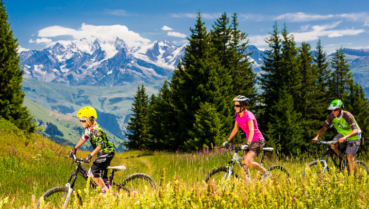 Family cycling with views of Mont Blanc